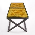 cast resin imprint of a cushion set into a metal frame/base with gilded detail