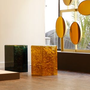 Abyssus 3 is a cast multi-coloured square resin coffee table with a gilded textured core