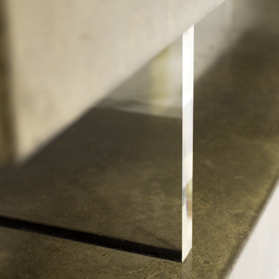 Long rectangular console table made of two scagliola beams with clear perspex uprights. surface resembles marble.
