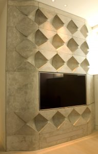 Special commission of the Wall with a TV in cement coloured scagliola