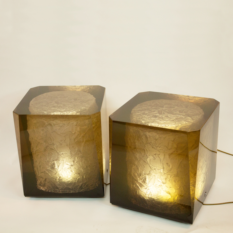 highly polished resin cast plinth illuminated by LED lights inside the textured core