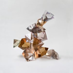resin crystalation sculpture made of faceted quartz and clear coloured crystals.