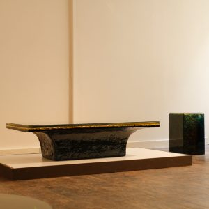 Abyssus 2 is a cast multi-coloured resin coffee table with a gilded textured core