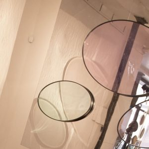 Mirage mirror reflections. Rose or Sapphire acrylic bubble covering a glass mirror in two sizes
