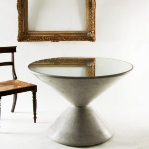 Bobbin shaped centre table cast in cement coloured scagliola and topped with a glass mirror