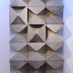 Funnel shaped blocks assembled to form a sculptural wall. Made in cement coloured scagliola