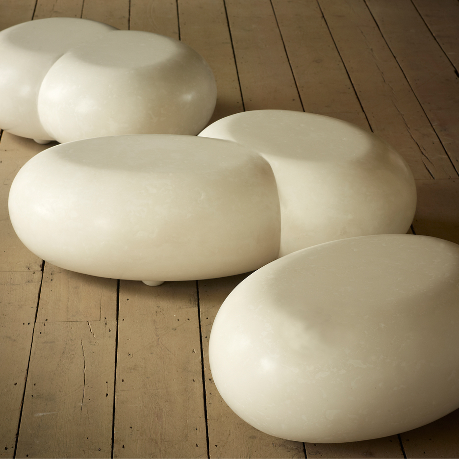 Oval low coffee table cast in white scagliola resembling marble. Double asymmetric version available.